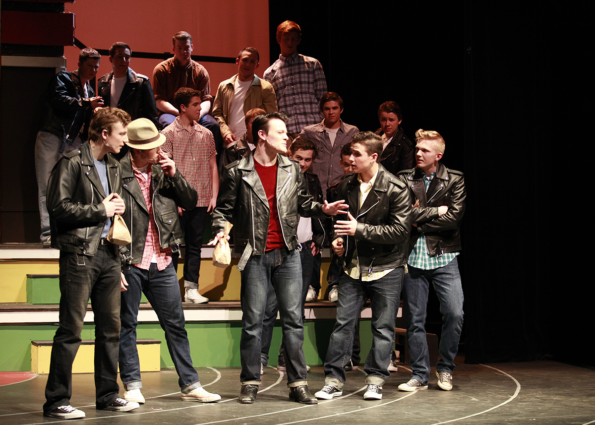 Danny Zuko (Daubney) and the boys at Grease / R. Colameco